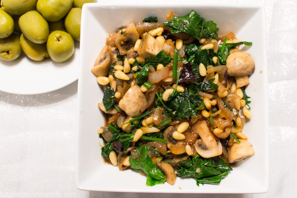Warm mushroom salad with pine nuts and greens - vegan