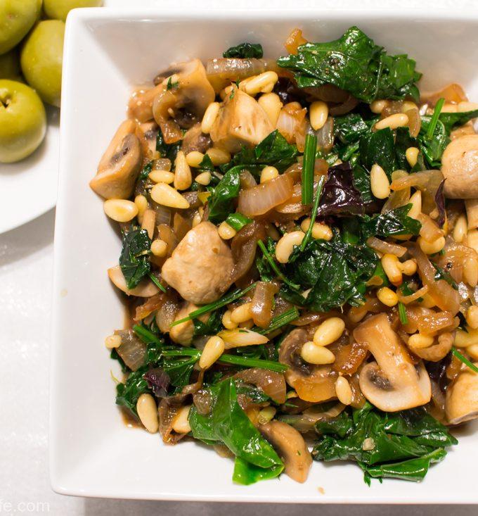 Warm mushroom salad with pine nuts and greens - vegan