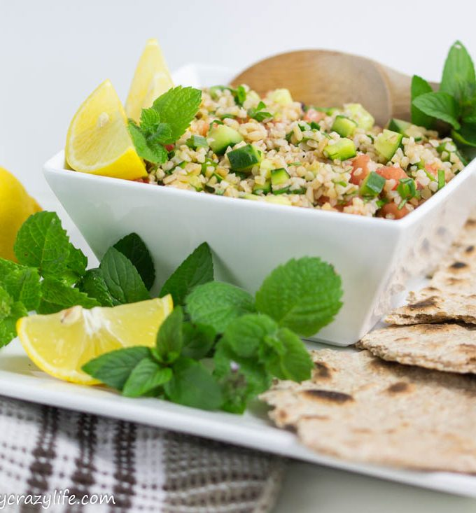 Tabbouleh Salad - a Mediterranean refreshing meal with bulgur, cucumbers, tomatoes, and herbs.